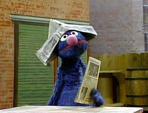 Grover-the-Newspaper-Salesman-grover-monster-20091736-300-230